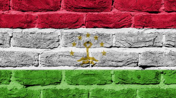 Parede de tijolos textura velho bandeira Tajiquistão construção Foto stock © michaklootwijk