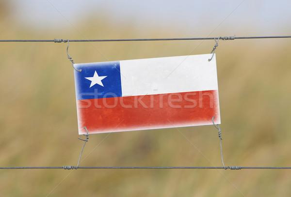 Keret kerítés öreg műanyag felirat zászló Stock fotó © michaklootwijk