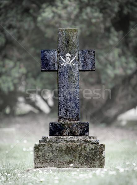 Gravestone in the cemetery - Pirate Stock photo © michaklootwijk
