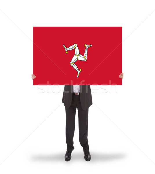 Smiling businessman holding a big card, flag of Isle of Man Stock photo © michaklootwijk