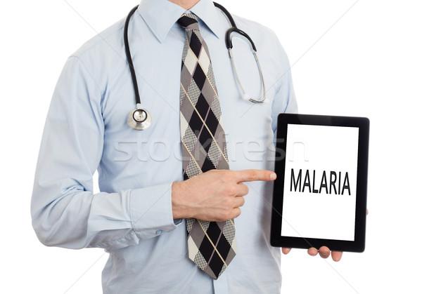 Doctor holding tablet - Malaria Stock photo © michaklootwijk