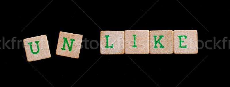 Letters on wooden blocks (unlike) Stock photo © michaklootwijk