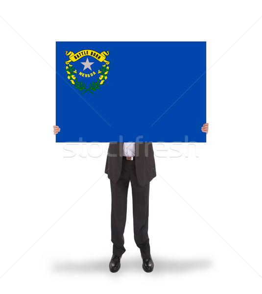 Gülen işadamı büyük kart bayrak Stok fotoğraf © michaklootwijk