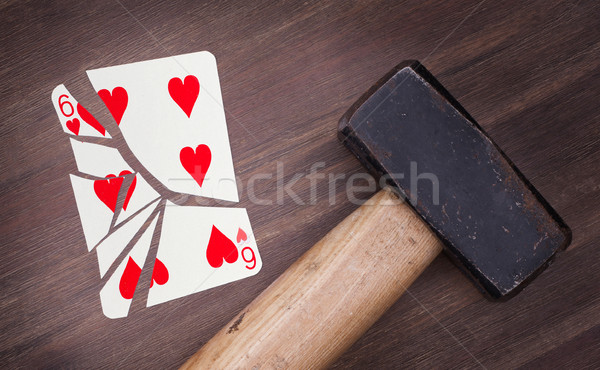 Hammer with a broken card, six of hearts Stock photo © michaklootwijk