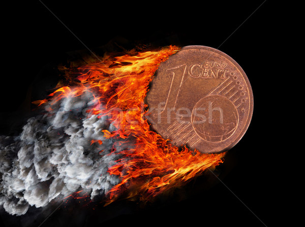 Burning coin with a trail of fire and smoke Stock photo © michaklootwijk