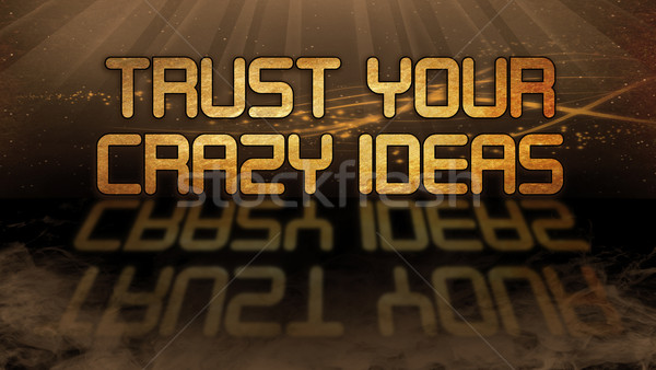 Gold quote - Trust your crazy ideas Stock photo © michaklootwijk