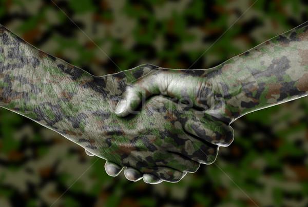 Férfi nő kézfogás kéz zöld csapat Stock fotó © michaklootwijk