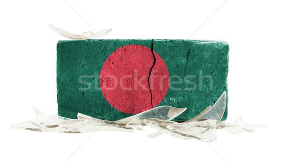 Tijolo cacos de vidro violência bandeira Bangladesh parede Foto stock © michaklootwijk