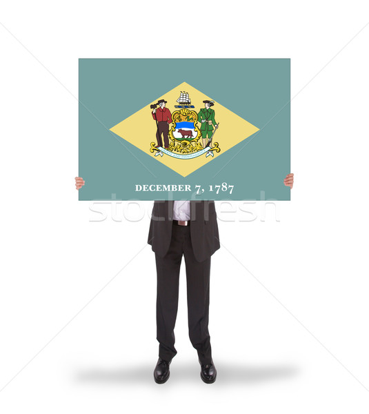 Smiling businessman holding a big card, flag of Delaware Stock photo © michaklootwijk