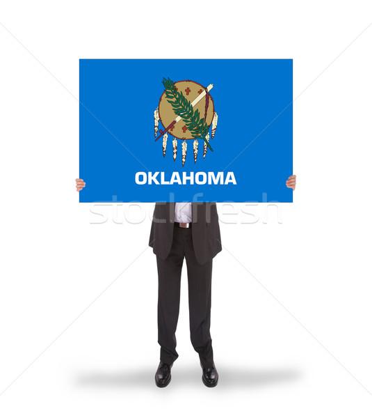 Sorridente empresário grande cartão bandeira Foto stock © michaklootwijk