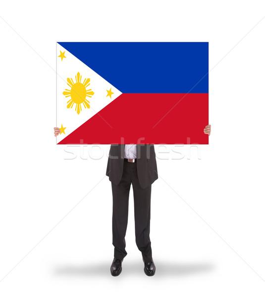 Işadamı büyük kart bayrak Filipinler Stok fotoğraf © michaklootwijk