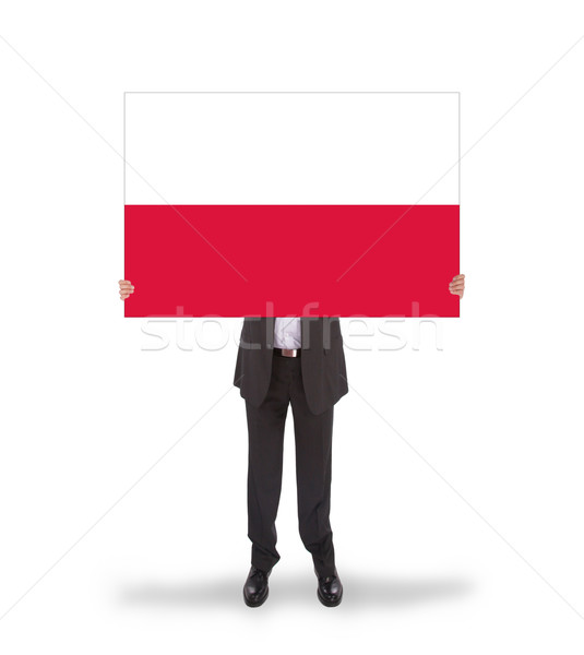 Smiling businessman holding a big card, flag of Poland Stock photo © michaklootwijk