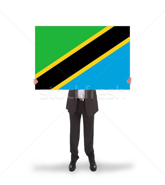 Geschäftsmann halten groß Karte Flagge Tansania Stock foto © michaklootwijk