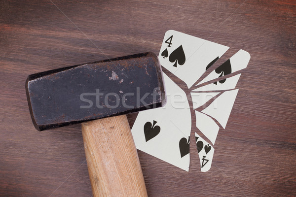 Hammer with a broken card, four of spades Stock photo © michaklootwijk