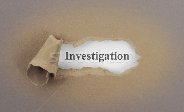 Stock photo: Text appearing behind torn brown envelop