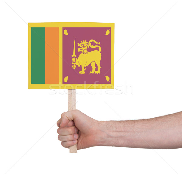Hand holding small card - Flag of Sri Lanka Stock photo © michaklootwijk