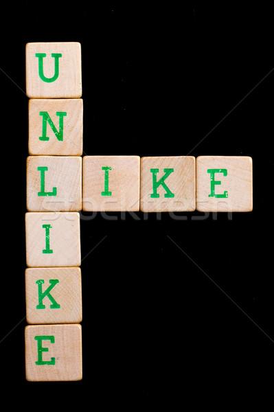 Letters on wooden blocks (like, unlike) Stock photo © michaklootwijk