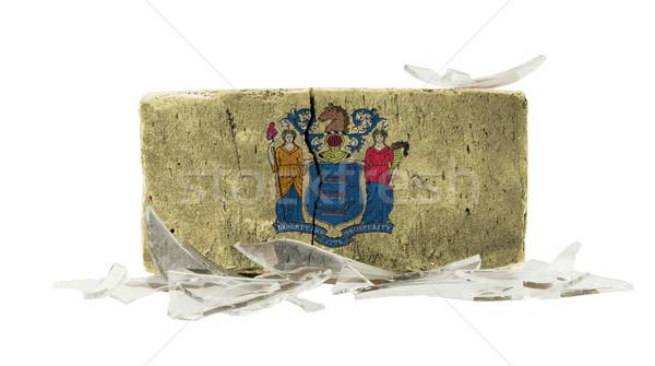 Tijolo cacos de vidro violência bandeira New Jersey parede Foto stock © michaklootwijk