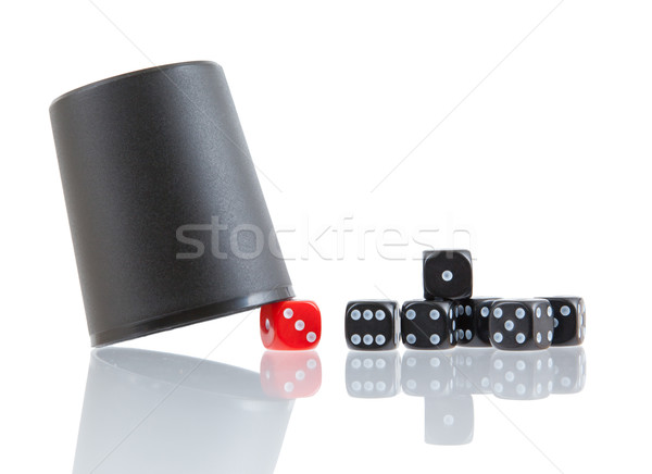 Gambling background with dice and dice cup Stock photo © michaklootwijk