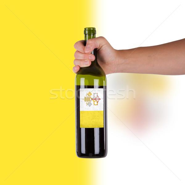 Mano botella vino tinto etiqueta Ciudad del Vaticano Foto stock © michaklootwijk