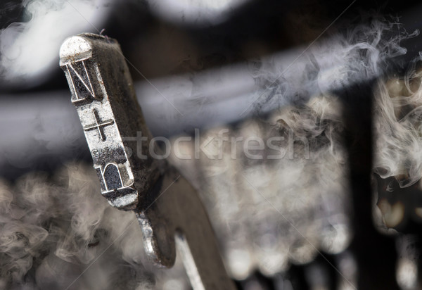 N hammer - old manual typewriter - mystery smoke Stock photo © michaklootwijk