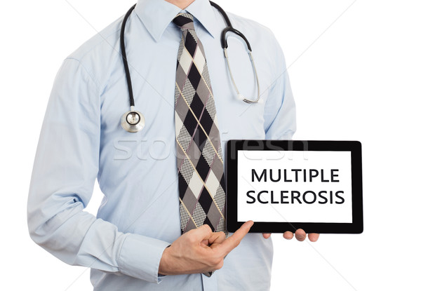 Doctor holding tablet - Multiple sclerosis Stock photo © michaklootwijk
