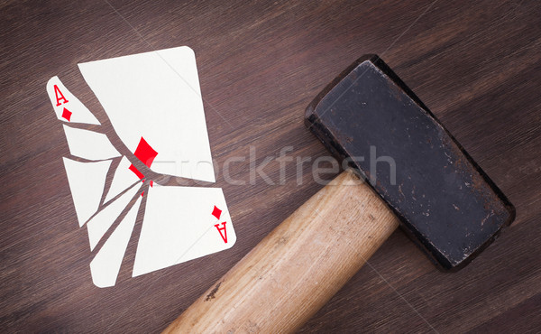 Stock photo: Hammer with a broken card, ace of diamonds