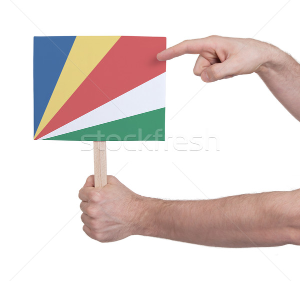 Stock photo: Hand holding small card - Flag of Seychelles