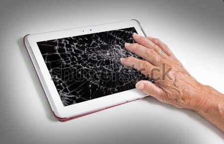 Senior lady with tablet, cracked screen Stock photo © michaklootwijk