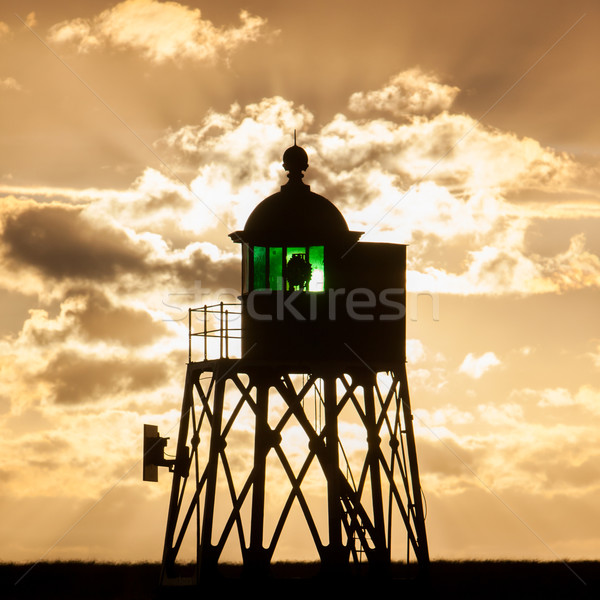 Silhouette of a green beacon at the dutch coast Stock photo © michaklootwijk