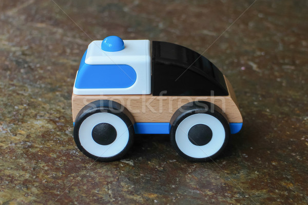 Simple wood and plastic toy police car Stock photo © michaklootwijk