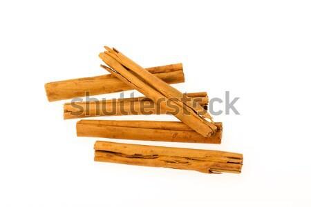 Five cinnamon sticks isolated on white background Stock photo © michaklootwijk