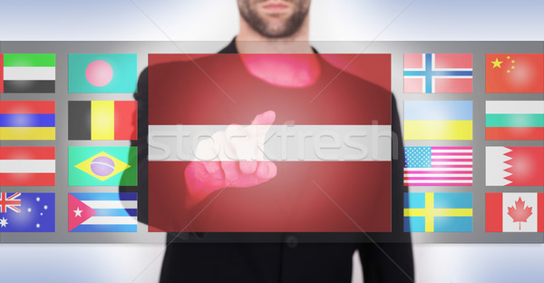 Hand pushing on a touch screen interface Stock photo © michaklootwijk
