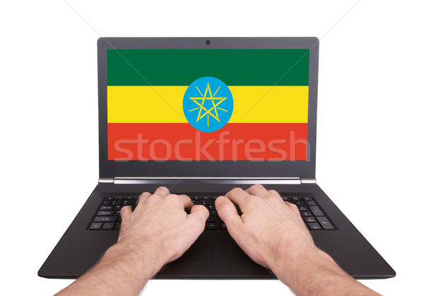 Hands working on laptop, Ethiopia Stock photo © michaklootwijk