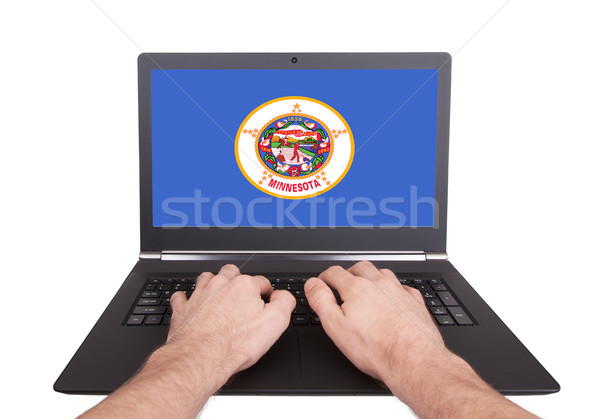 Hands working on laptop, Minnesota Stock photo © michaklootwijk