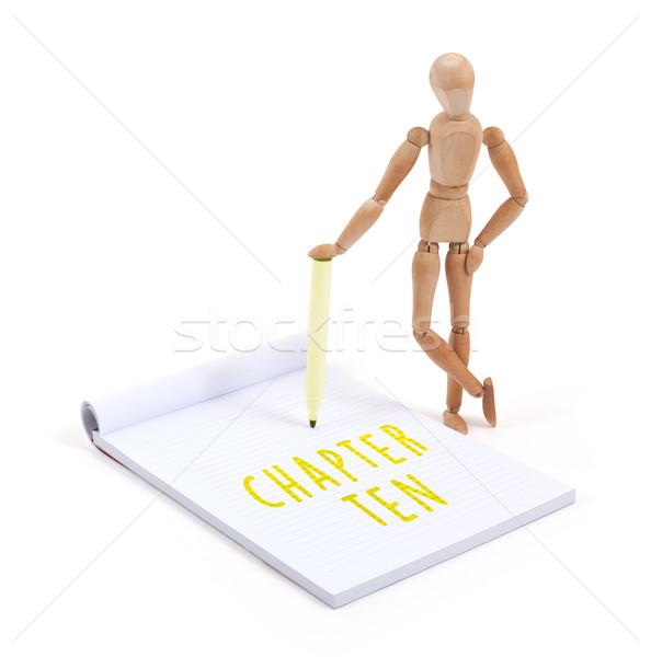 Stock photo: Wooden mannequin writing - Chapter ten