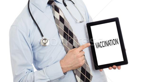 Médico tableta vacunación aislado blanco Foto stock © michaklootwijk