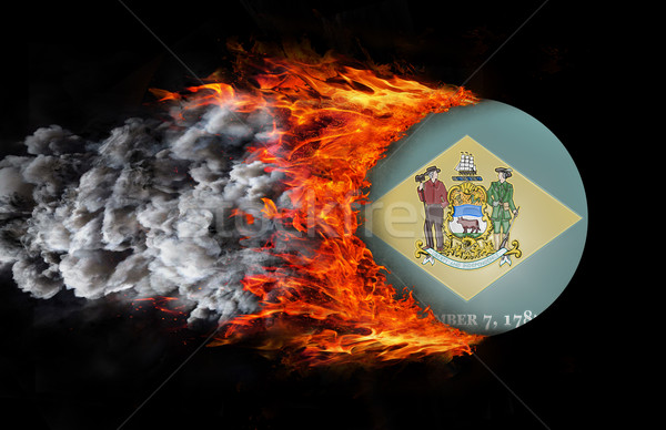 Flag with a trail of fire and smoke - Delaware Stock photo © michaklootwijk