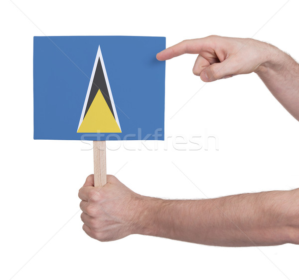 Hand holding small card - Flag of Saint Lucia Stock photo © michaklootwijk