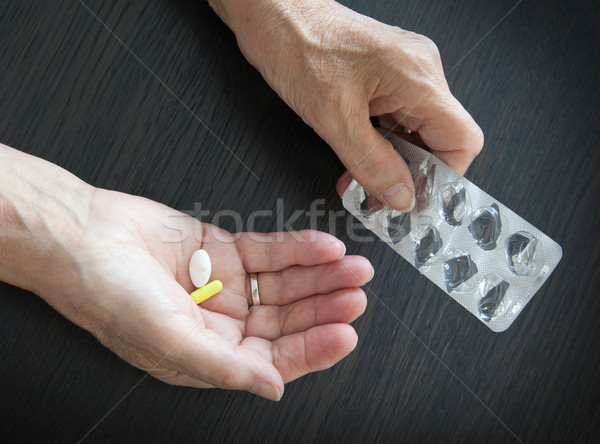 Elderly person taking medication Stock photo © michaklootwijk