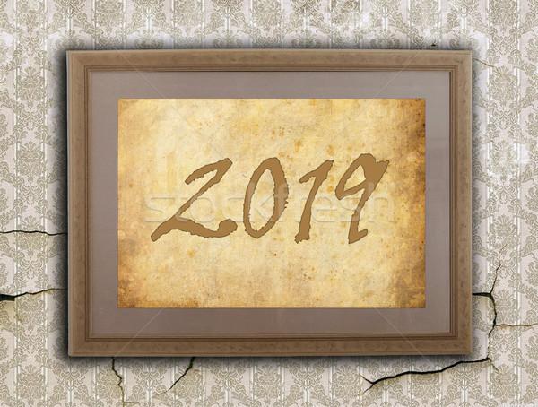 Velho quadro papel pardo ano novo parede assinar Foto stock © michaklootwijk
