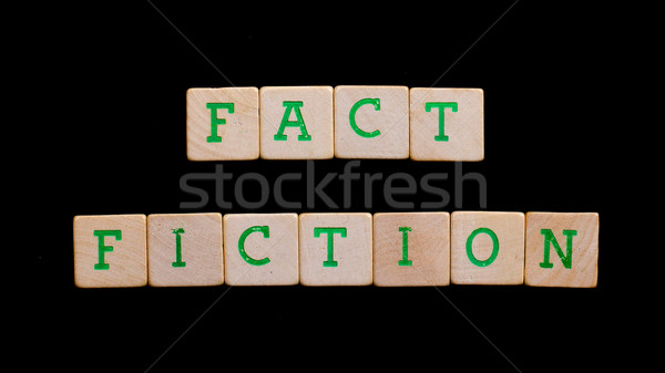Letters on old wooden blocks (fact, fiction) Stock photo © michaklootwijk