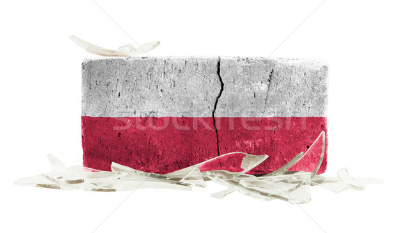 Mattone vetri rotti violenza bandiera Polonia muro Foto d'archivio © michaklootwijk