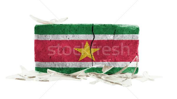 Stockfoto: Baksteen · gebroken · glas · geweld · vlag · Suriname · muur