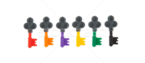 Six small keys, each with a different color Stock photo © michaklootwijk