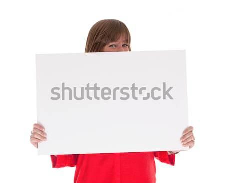 Utangaç kadın büyük boş kart yalıtılmış Stok fotoğraf © michaklootwijk