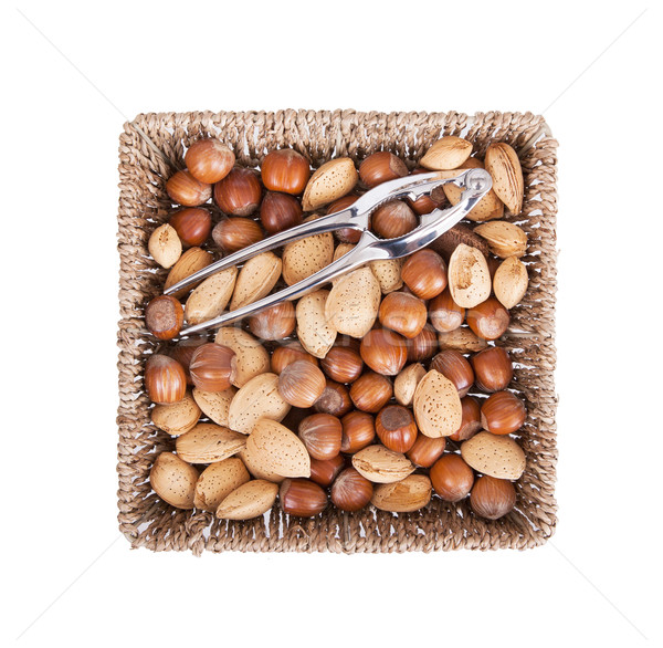 Mixed nuts in a woven basket with nut cracker Stock photo © michaklootwijk