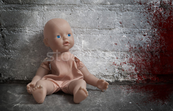 Concept of child abuse - Bloody doll Stock photo © michaklootwijk