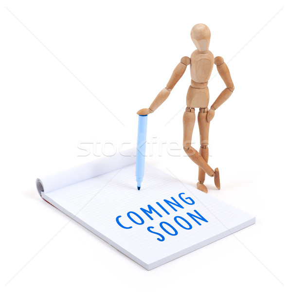 Wooden mannequin writing - Coming soon Stock photo © michaklootwijk