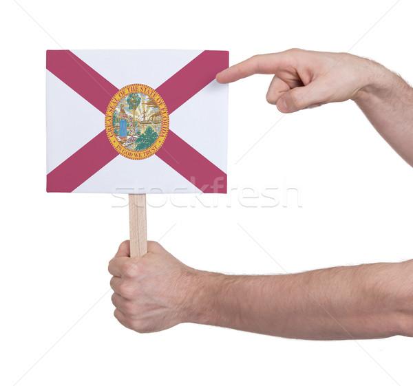 Kéz tart kicsi kártya zászló Florida Stock fotó © michaklootwijk